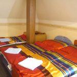 Panorámás városra néző négyágyas szoba