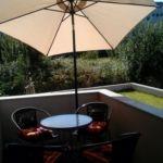 2-Zimmer-Apartment für 4 Personen mit Balkon und Aussicht auf den Garten