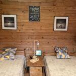 2-Zimmer-Apartment für 4 Personen mit Aussicht auf den Wald und Panorama auf den See