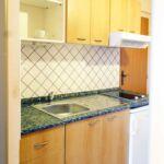 Zuhanyzós saját konyhával egyágyas szoba